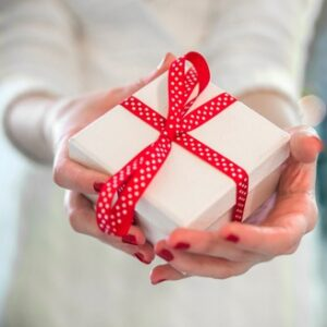 woman-hands-holding-a-gift-box_1391-784.jpg